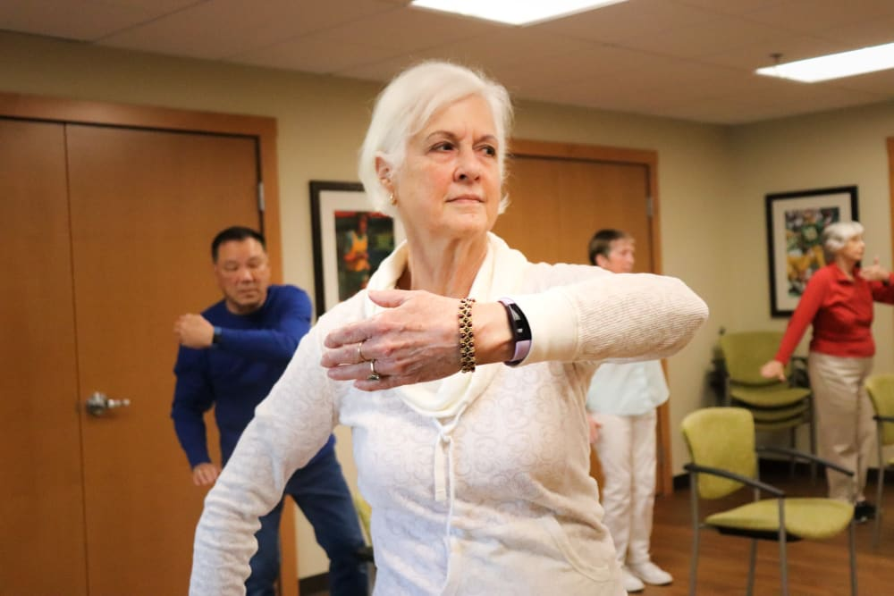 Residents partaking in group fitness class at The Springs at Carman Oaks in Lake Oswego, Oregon