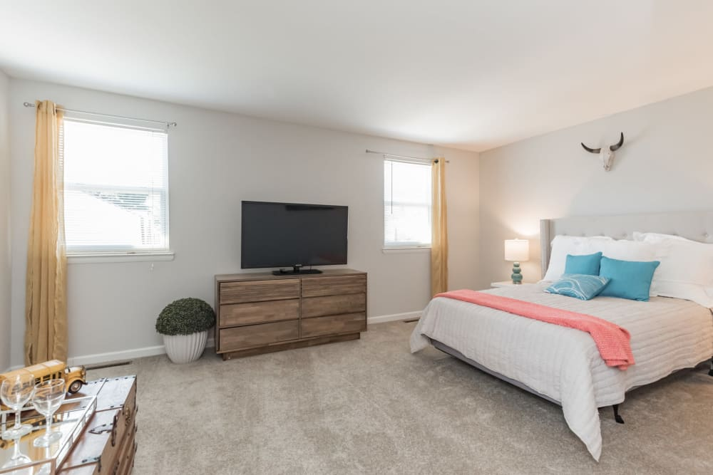 An spacious bedroom with windows at The Springs in Parkville, Maryland