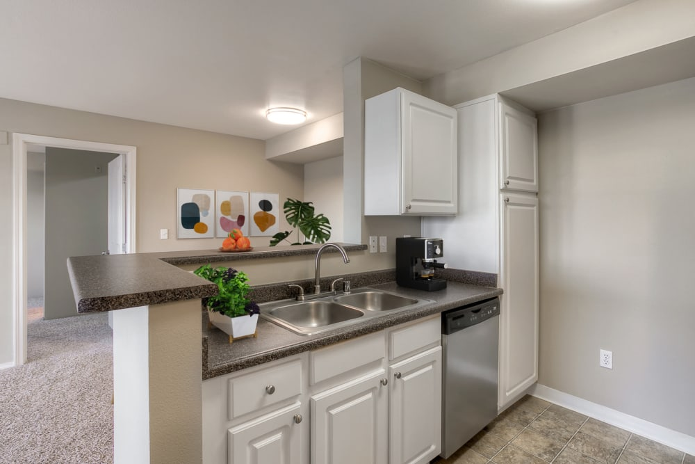 Kitchen with granite-style counter tops at Pebble Cove Apartments in Renton, Washington