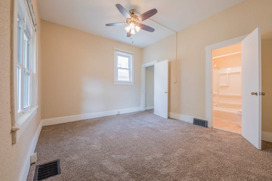 Spacious bedroom in Des Moines, Iowa at Pleasant Street Apartments