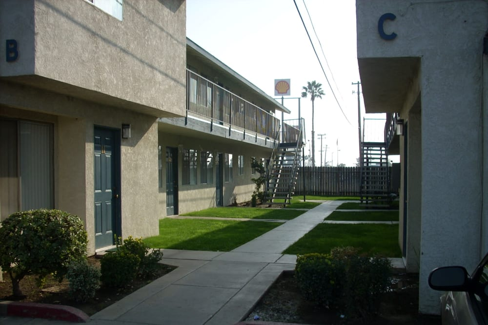 Outdoor walkways at El Potrero Apartments in Bakersfield, California