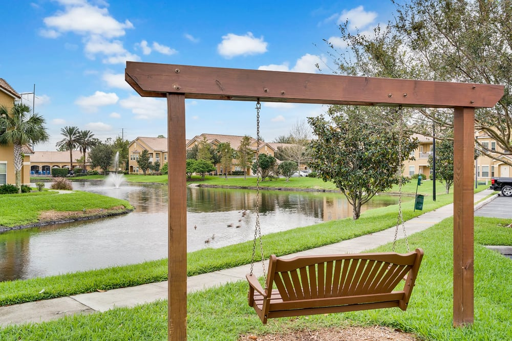 Outdoor patio swing with view of the water at Palms at World Gateway in Orlando, Florida