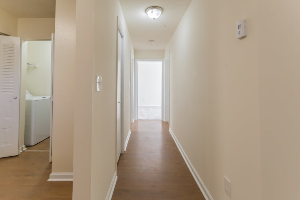 Entry hallway with hard wood floors at Vista Point Apartments in Wappingers Falls, New York
