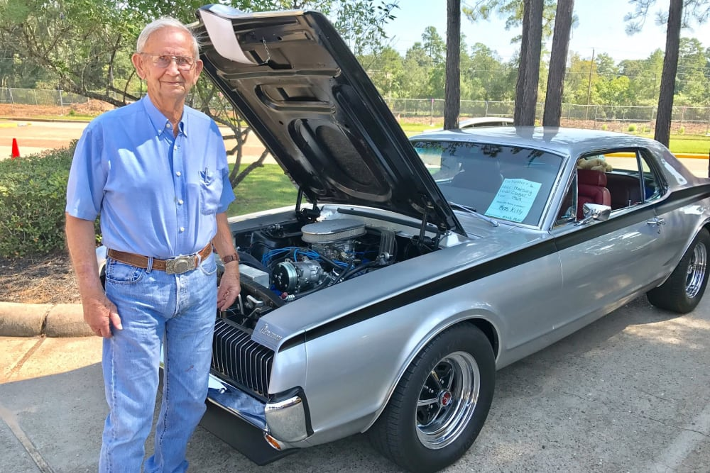 Resident with his silver car at Parsons House Cypress in Cypress, Texas