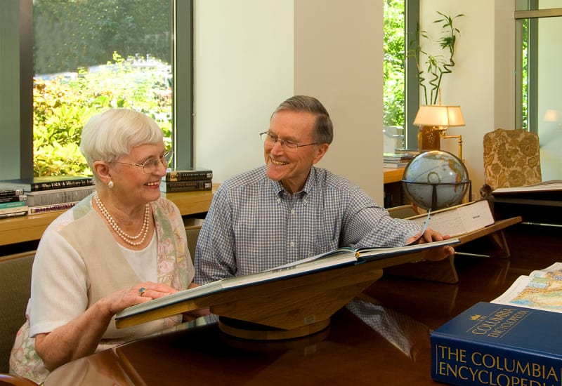 Residents in the library at Carefield Living.