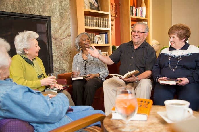 Book club meeting for residents at All Seasons of Rochester Hills in Rochester Hills, Michigan