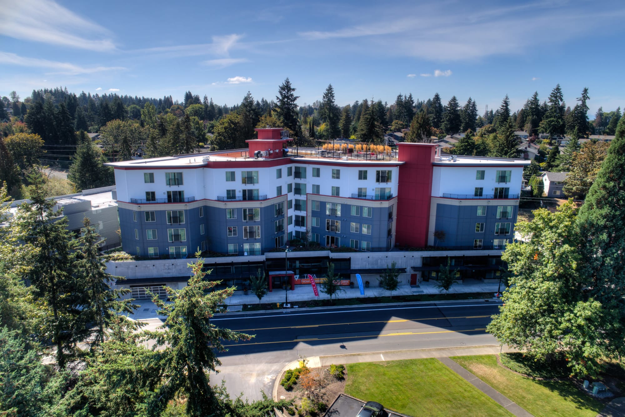Aerial view of Tria Apartments showing off its beautiful, forested surroundings.
