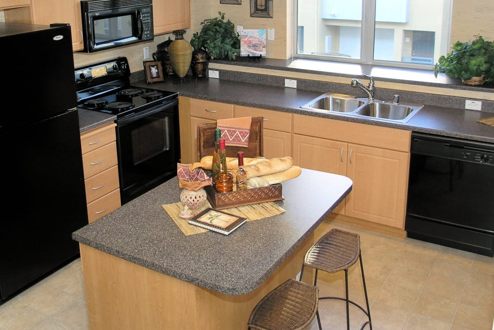 Kitchen with island at Azure Apartment Homes in Petaluma, California