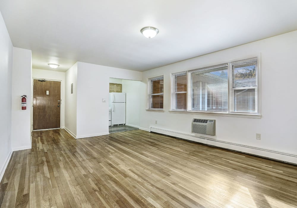 Living room with hardwood flooring at Garret Village Apartments in Clifton, New Jersey