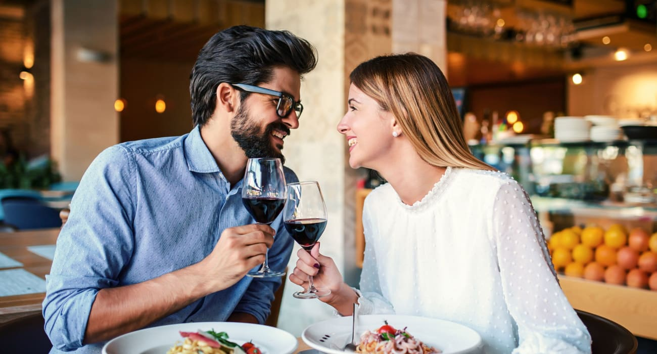Couple out enjoying a delicious meal and wine in Caldwell, New Jersey near Parkway East Apartments