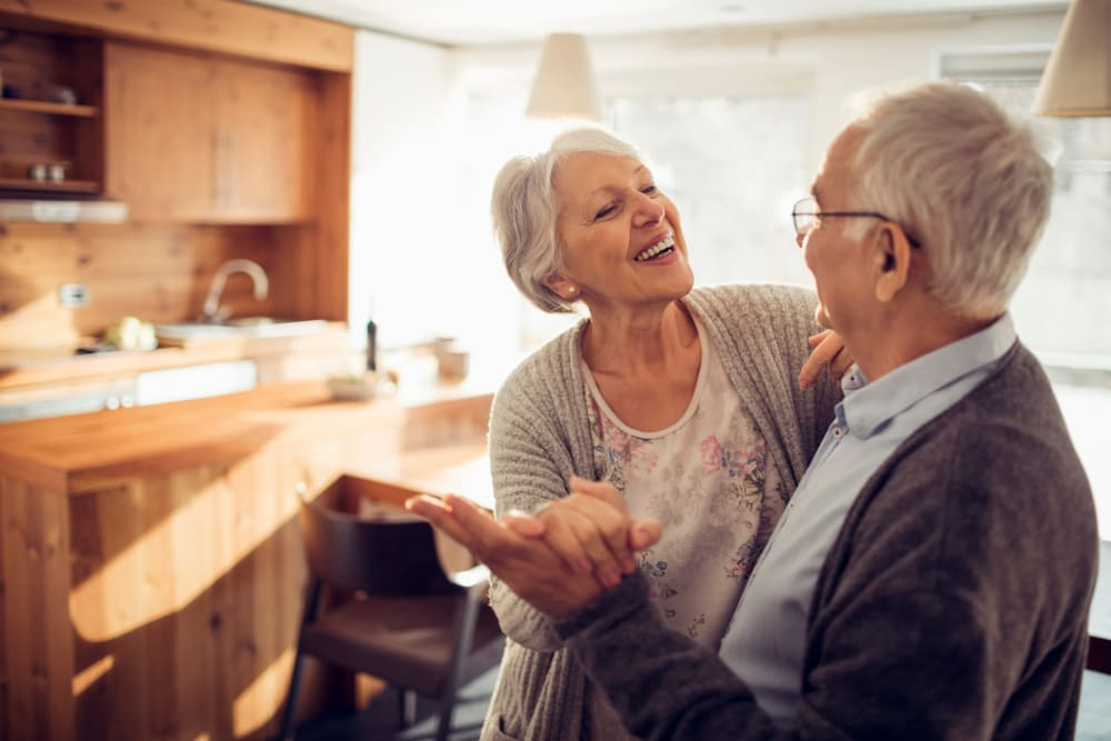 Two residents dancing in their apartment at Quail Park of Lynnwood in Lynnwood, Washington