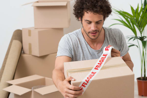 A man packing boxes to store at Baton Rouge Self Storage