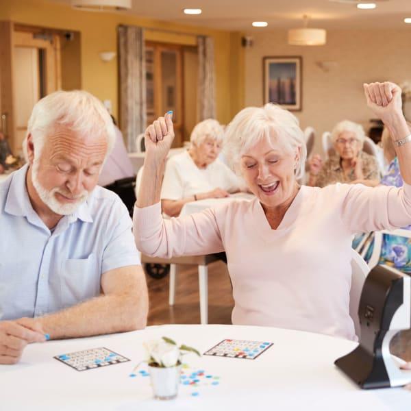 Residents playing bingo at Pacifica Senior Living Menifee in Sun City, California.