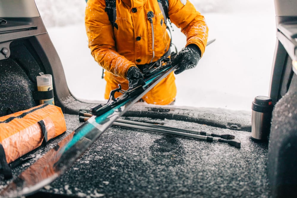 A customer putting skis in a car near Storage Star South College in Fort Collins, Colorado