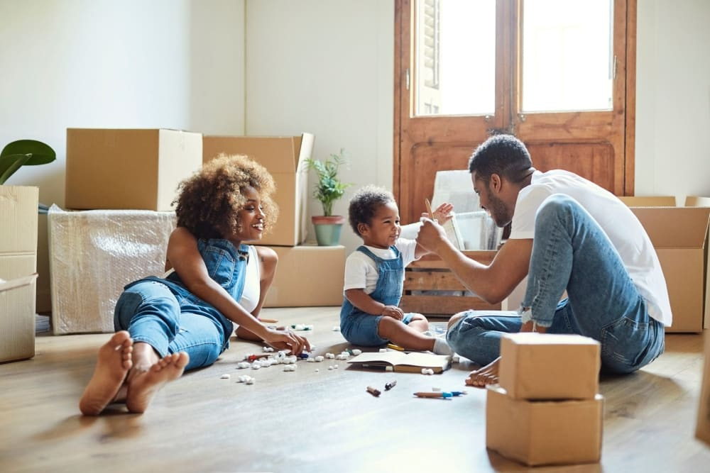 A family in El Cajon unpacks after a move.