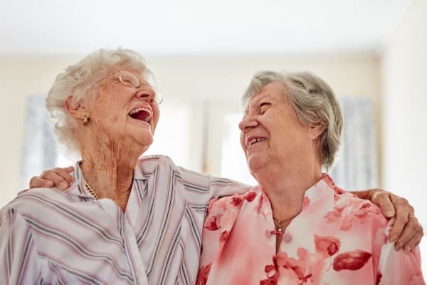 Two residents having a laugh