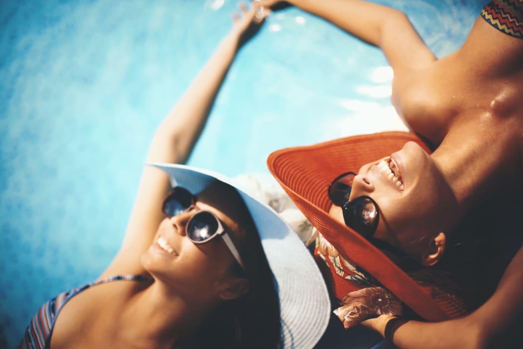 Residents at MiLO at Mountain Park enjoying the swimming pool!