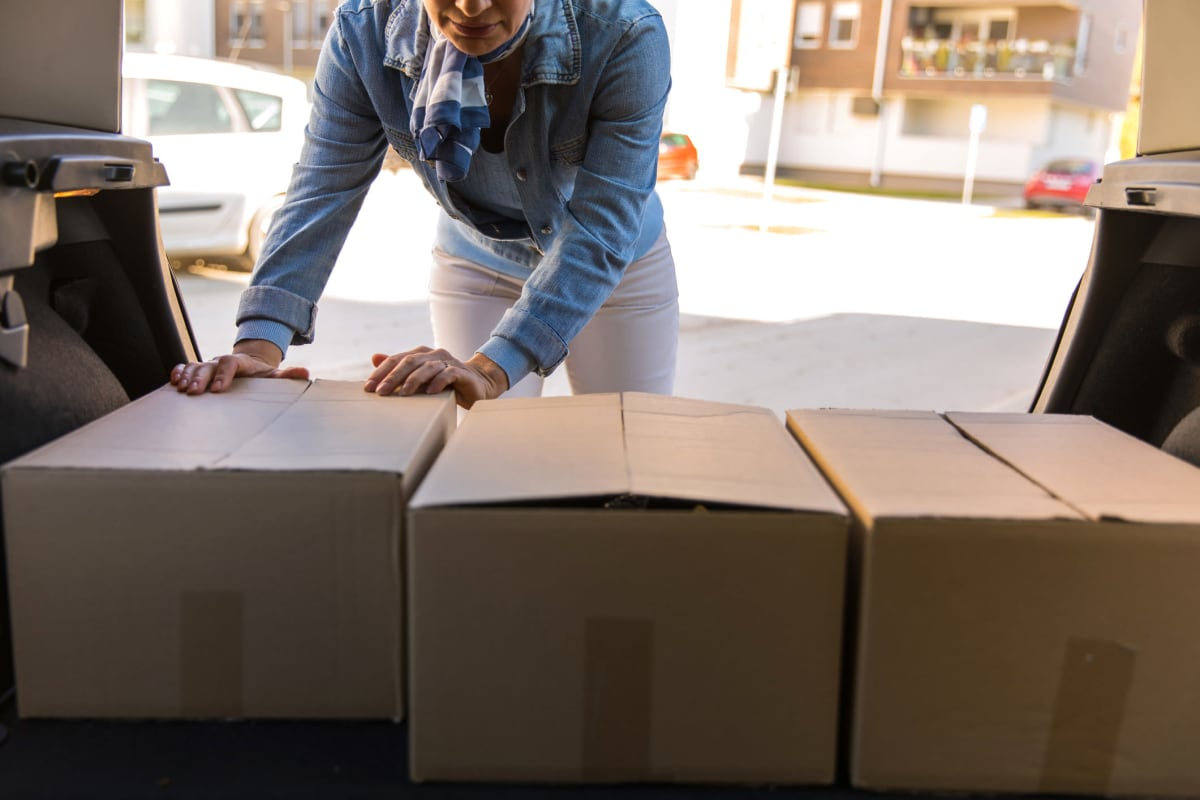 A customer packing boxes into a car to store at Red Dot Storage in Boulder, Colorado
