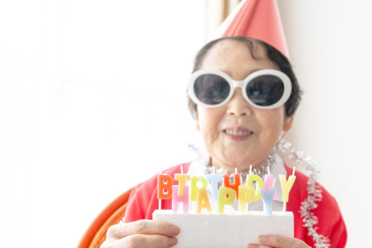 Resident celebrating her birthday at Oxford Glen Memory Care at Carrollton in Carrollton, Texas