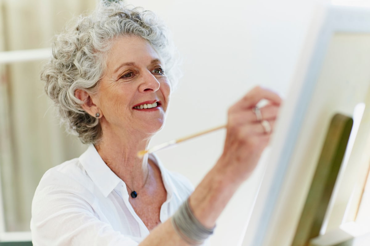 A resident painting at Oxford Villa Active Senior Apartments in Wichita, Kansas