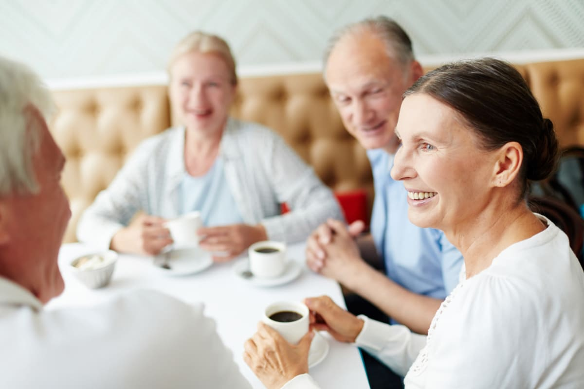 Residents enjoying coffee together at an Oxford Senior Living location