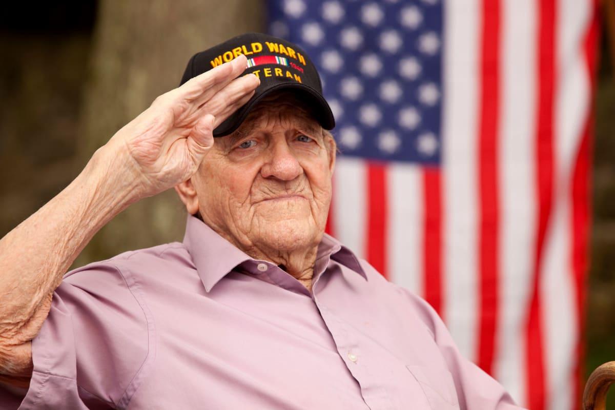 Army veteran saluting at Canoe Brook Assisted Living in Wichita, Kansas