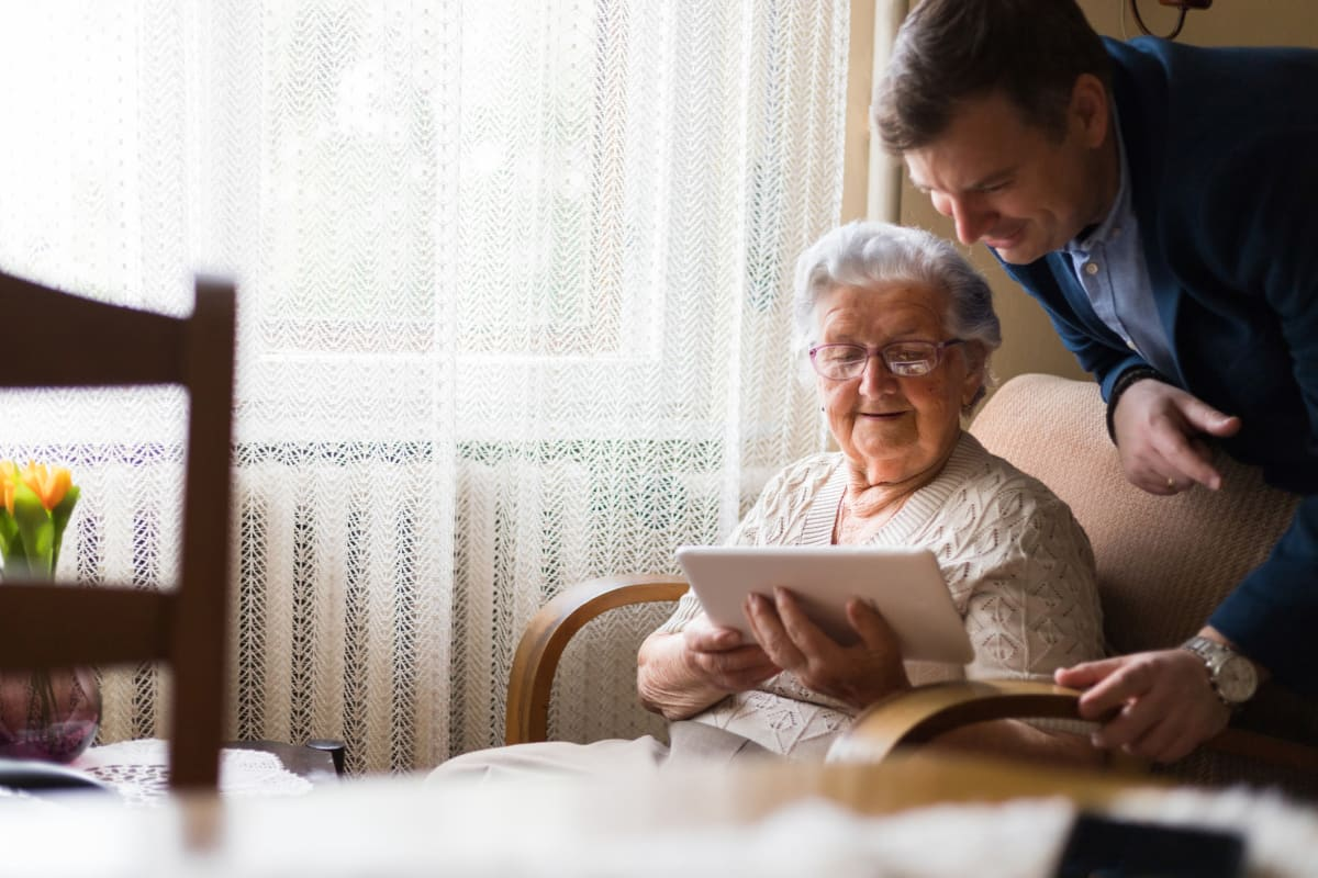 A resident using a tablet at Ashbrook Village in Duncan, Oklahoma