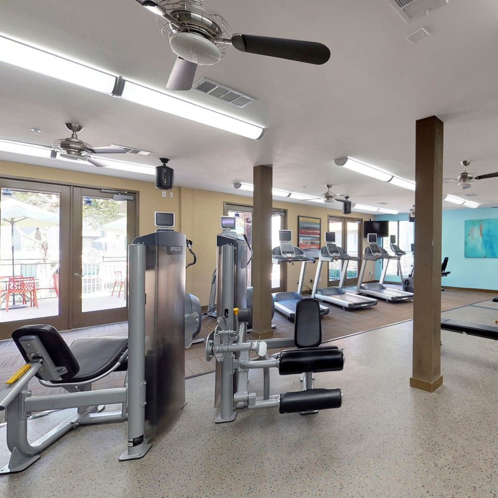 Well-equipped fitness center at Oaks 5th Street Crossing at City Station in Garland, Texas