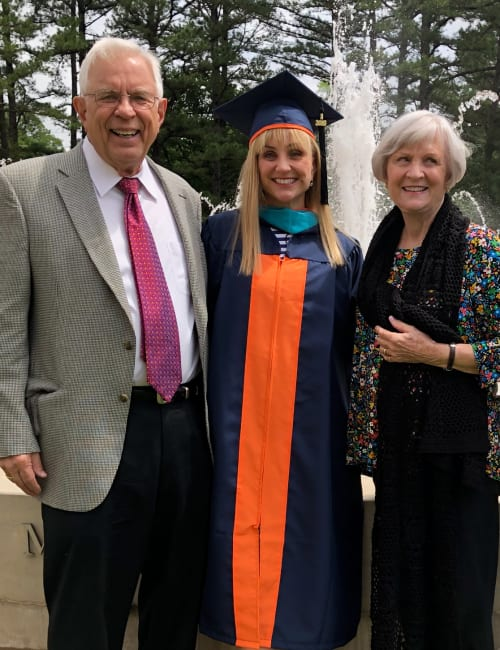 Residents and their granddaughter at her graduation near Inspired Living at Ocoee in Ocoee, Florida.