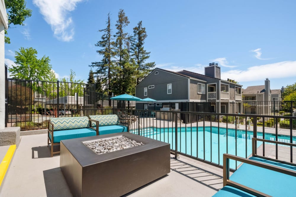 Fire pit next to a sparkling pool at Haven Martinez in Martinez, California