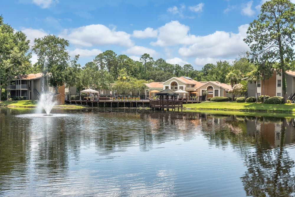 Exterior view of complex on the water at The Vue at Baymeadows Apartment Homes in Jacksonville, Florida
