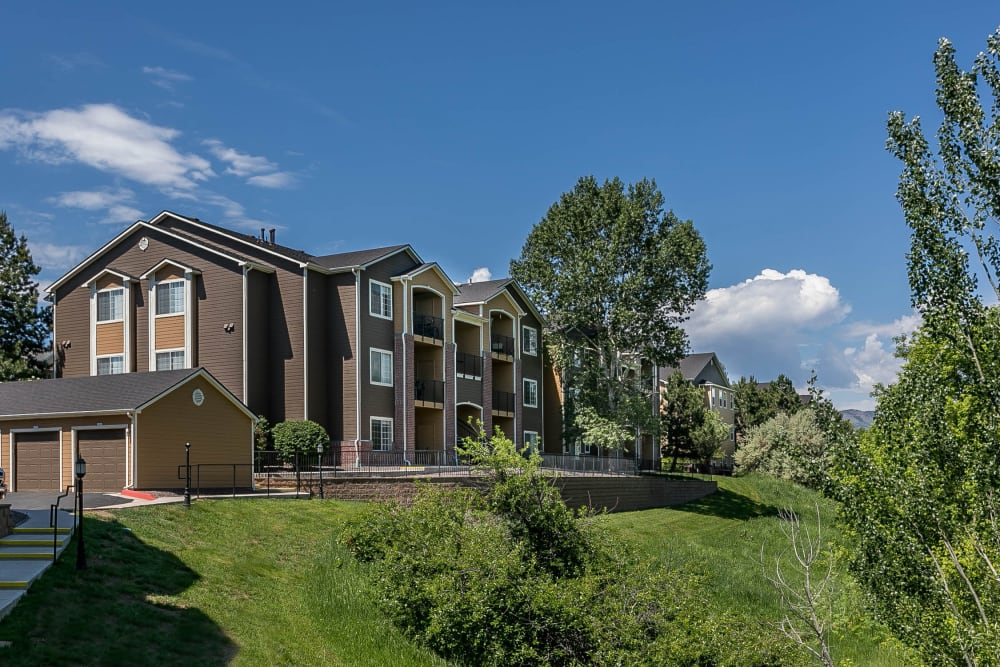 The exterior of The Crossings at Bear Creek Apartments in Lakewood, Colorado