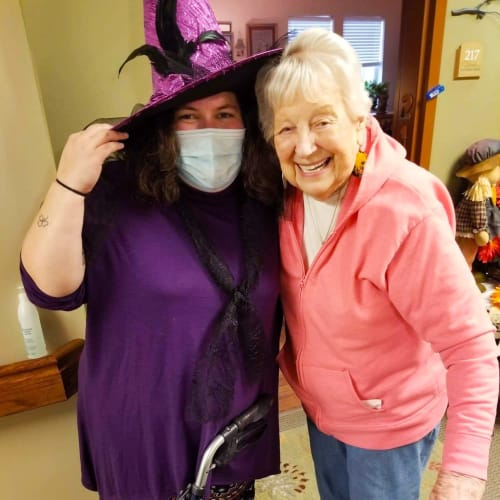 Masked caretaker with a resident at The Oxford Grand Assisted Living & Memory Care in Wichita, Kansas