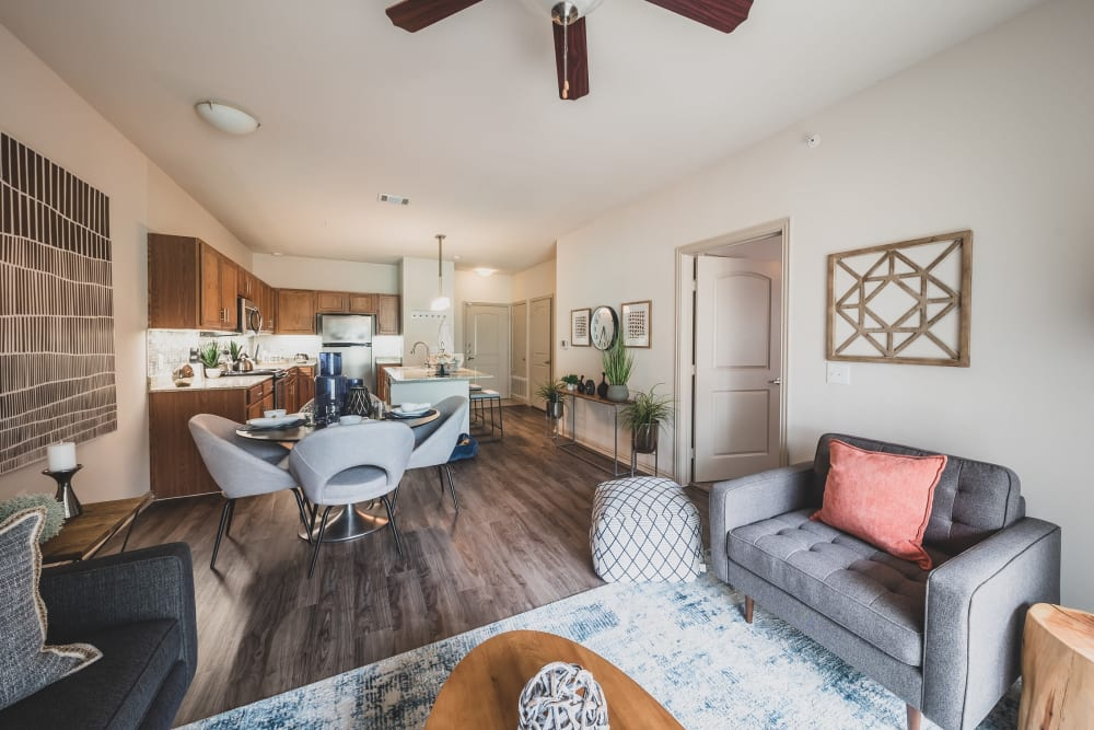 Open concept living room with hardwood floors at Evolv in Mansfield, Texas
