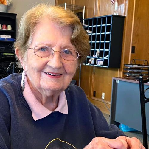 Smiling resident at Canoe Brook Assisted Living in Ardmore, Oklahoma