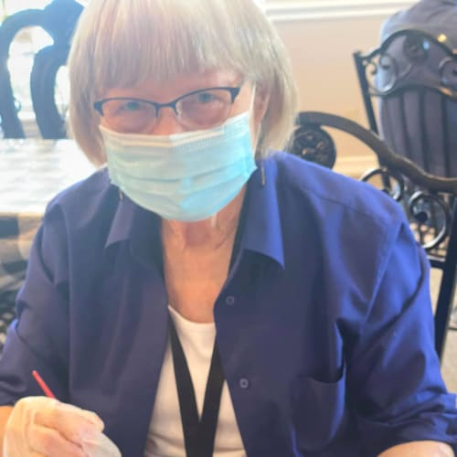 A resident painting a mug at Canoe Brook Assisted Living in Ardmore, Oklahoma