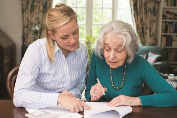 Resident and her daughter looking over papers