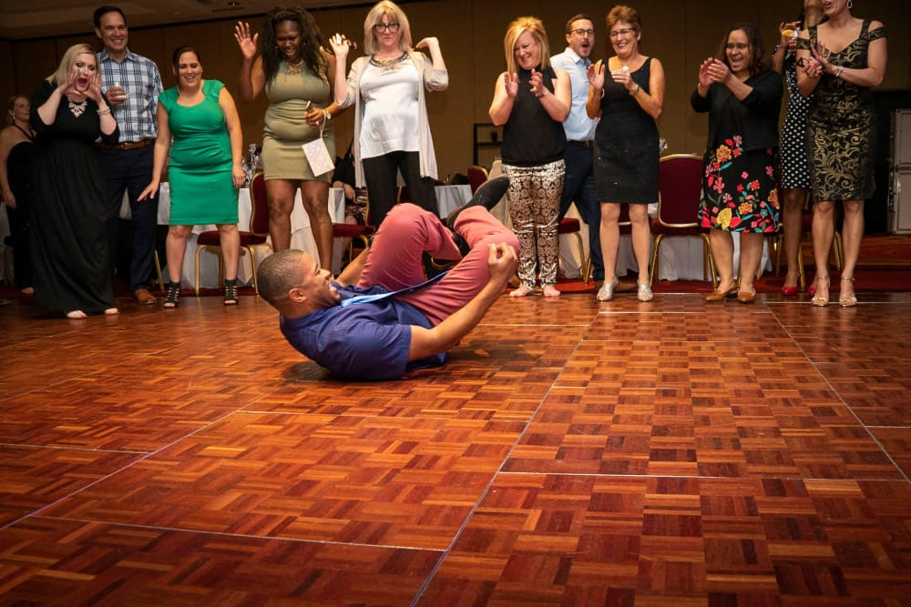 CAPREIT employee break dancing at a conference