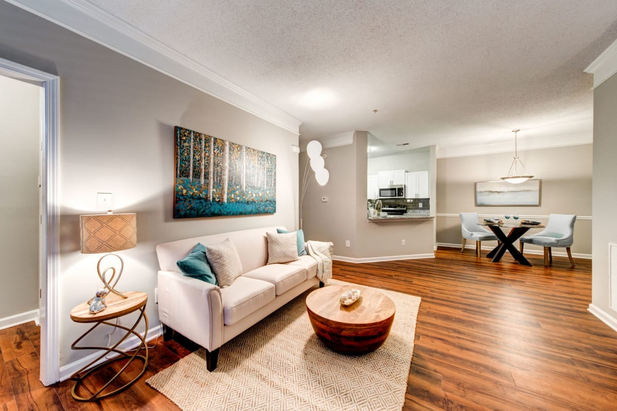 Open living room with wood floors and rug at Marquis on Edwards Mill in Raleigh, North Carolina