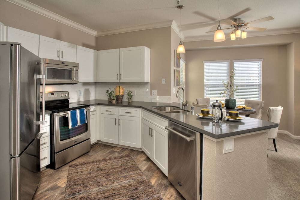 State-of-the-art kitchen with stainless-steel appliances at Iron Point at Prairie Oaks in Folsom, California