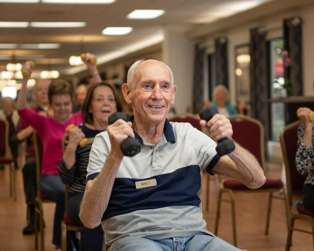 Residents enjoying a fitness class at WellQuest of Elk Grove in Elk Grove, California