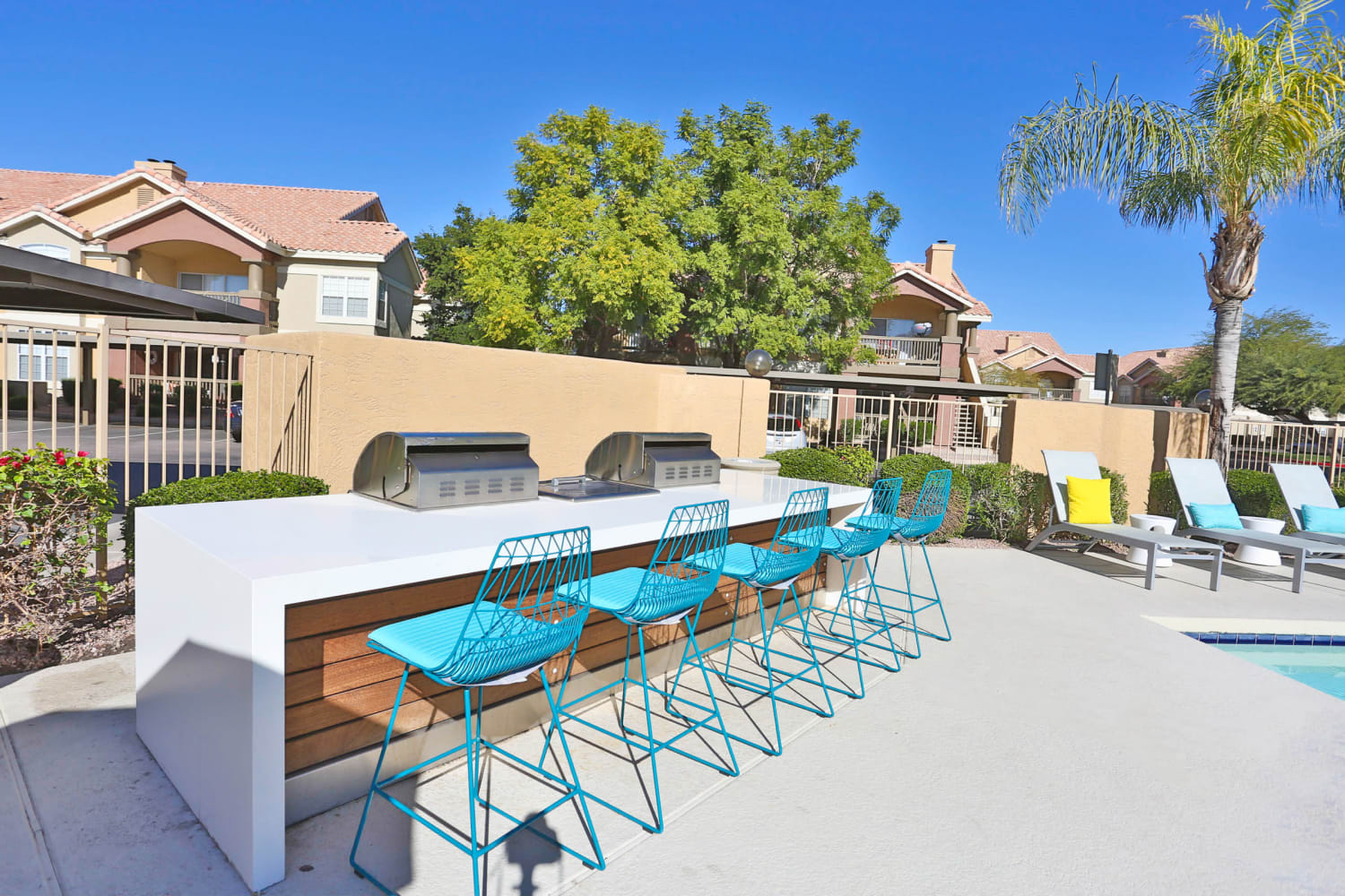 Sonoran Vista Apartments in Scottsdale, Arizona, offer access to a barbecue area near the pool