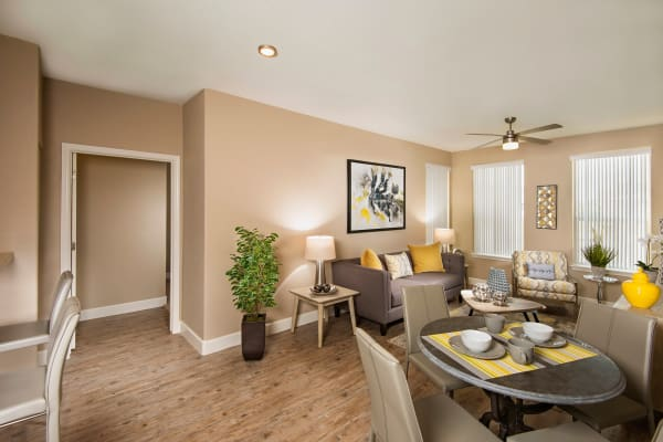 Luxury living room layout with autumn-toned furniture at Southern Avenue Villas