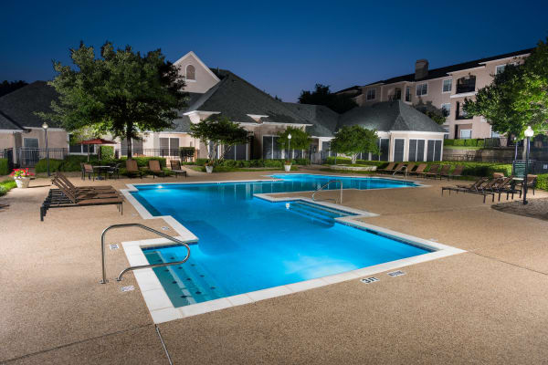 Night picture at one of the two pools at Ballantyne Apartments