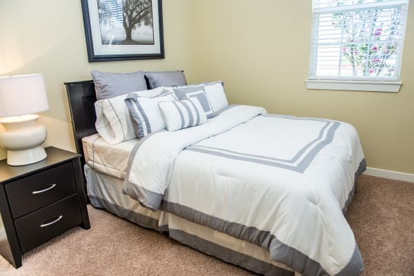 Bedroom with carpet at Traditions at Westmoore in Oklahoma City, Oklahoma