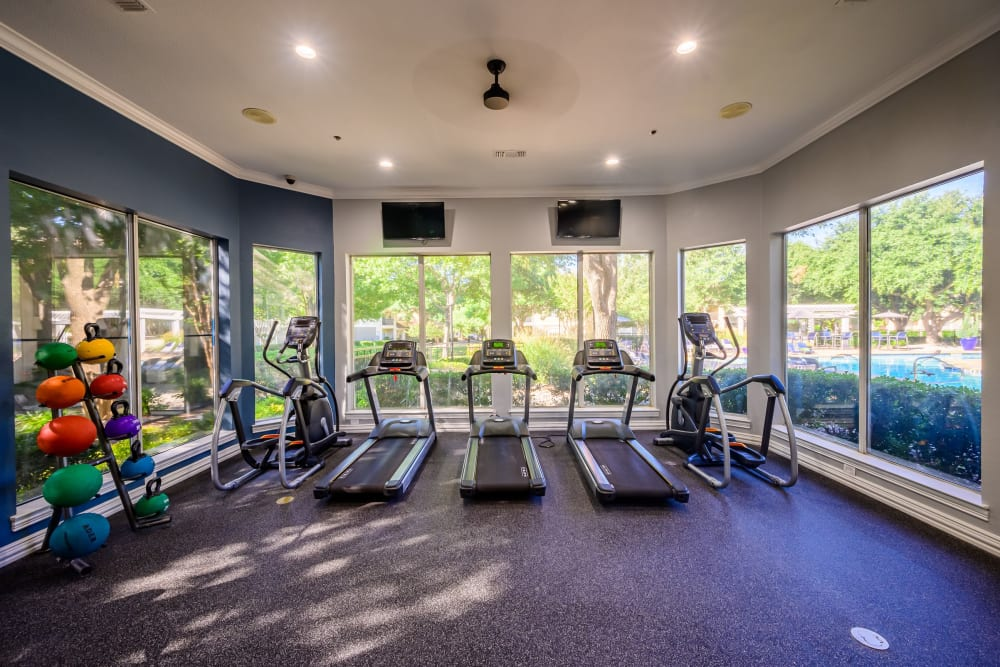 Well-equipped fitness center with terrific view of the community at 23Hundred @ Ridgeview in Plano, Texas