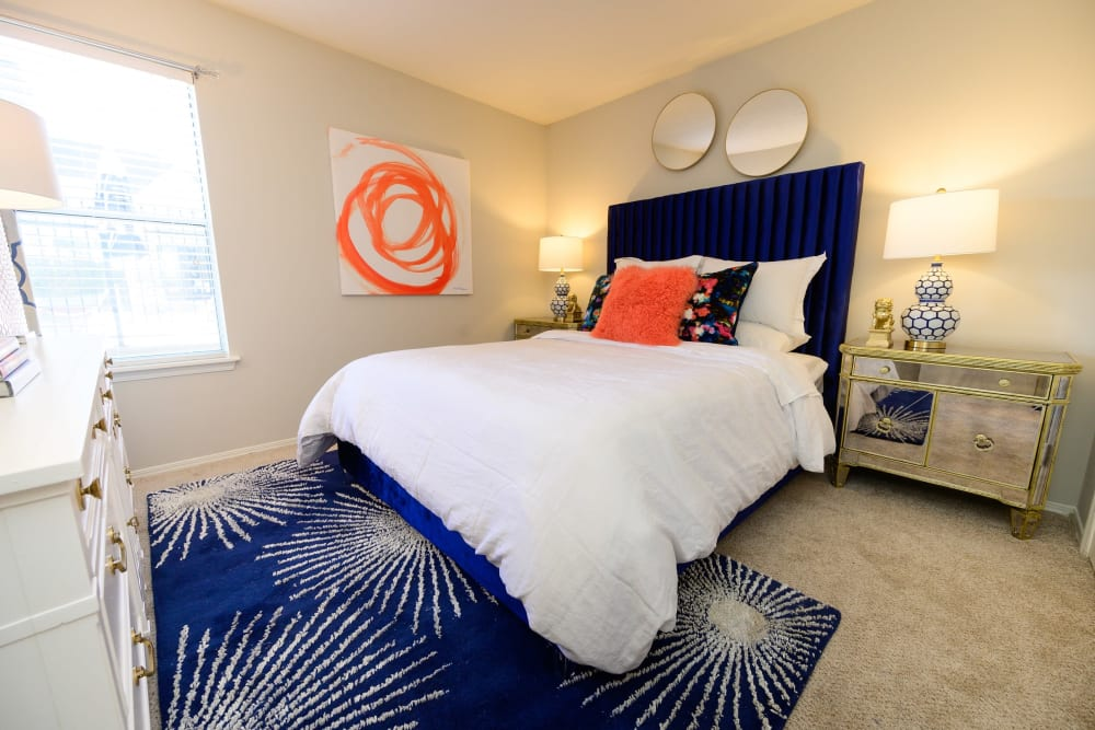Well-lit bedroom with plush carpeting in a model home at The Hamilton in Hendersonville, Tennessee