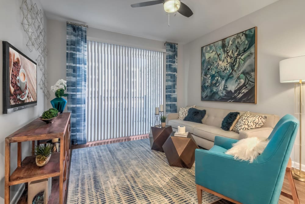 Ceiling fan and modern decor in a model home's living area at The Palmer in Charlotte, North Carolina