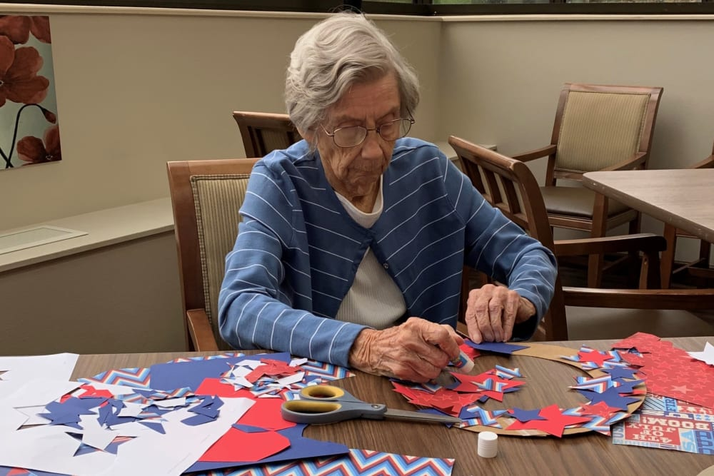 Resident making a wreath at Brown Deer Place in Coralville, Iowa