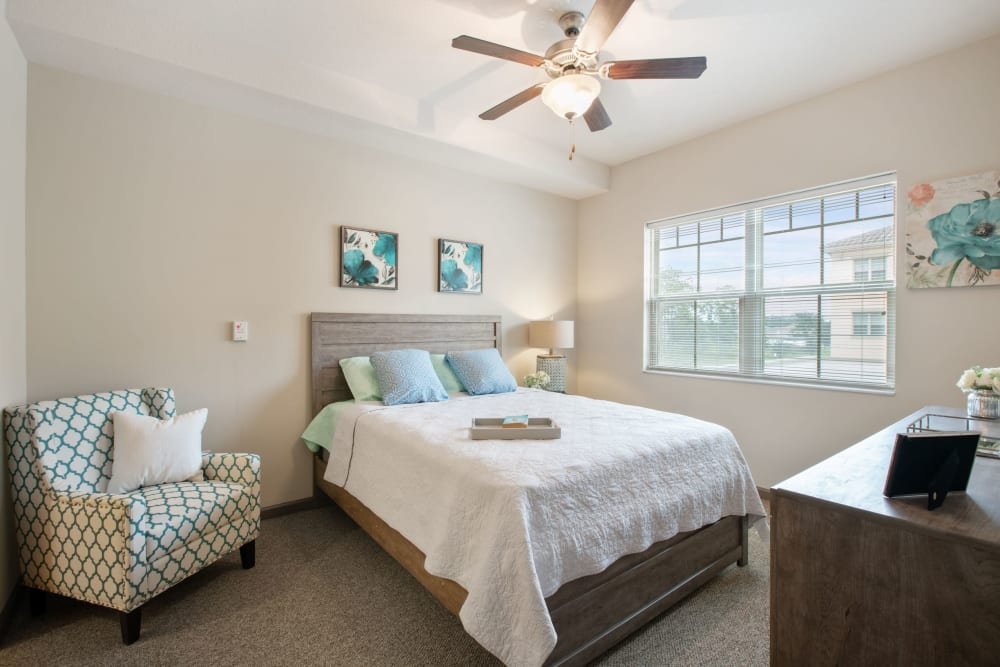 Large resident bedroom at Merrill Gardens at Solivita Marketplace in Kissimmee, Florida.